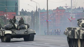 Military tanks invasion of the city, armored troop-carrier, war, smoke, danger. Russian army, special car transports Battle Tank stock video footage