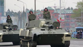 Military tanks invasion of the city, armored troop-carrier, war, smoke, danger. Russian army, special car transports Battle Tank stock footage