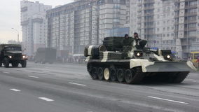 Military tanks invasion of the city, armored troop-carrier, war, smoke, danger. Russian army, special car transports Battle Tank stock video