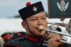 Military Tattoo  COLCHESTER ESSEX UK 8 July 2014:   Gurkha soldier blowing trumpet Royalty Free Stock Photos