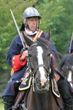 Military Tattoo  COLCHESTER ESSEX UK 8 July 2014:   Woman cavalry soldier Royalty Free Stock Images
