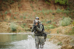Military team crossing the river under fire Stock Photo