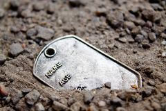 Military token closeup. Military token in the sand closeup Royalty Free Stock Photography