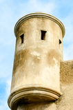 Military tower with gun slots above fort wall Royalty Free Stock Photo