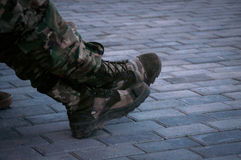 Military training boots on fragmental rocks Royalty Free Stock Photos