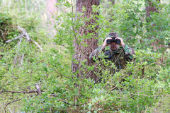Military training combat. Forest/jungle environment - observing/spying Stock Photo