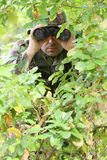 Military training combat. Forest/jungle environment - observing/spying Royalty Free Stock Photo