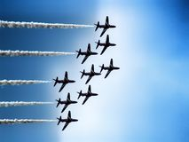Military training jet aircraft aerobatic team. Aerobatic team over Polish sky. Hawk training aircraft in diamond formation making a turn during Radom Air show stock image