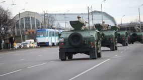 Military transport in city streets stock video