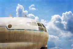 Military transport plane, blue sky background Stock Photo