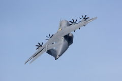Military transport plane climbing steeply Royalty Free Stock Photo