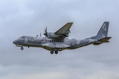 Military transport plane. Military turboprop transport plane on approach to land Stock Photo