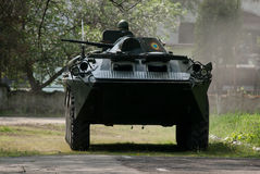 Military transportation. Amphibious military vehicle on the road Royalty Free Stock Images