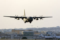Military transporter landing in the evening Stock Image