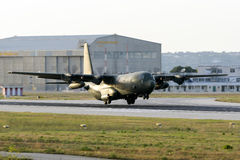 Military transporter landing in the evening Royalty Free Stock Image