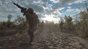 Military troop sitting and aiming stock footage