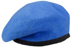 Military troops blue beret. Isolated royalty free stock photography