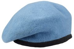 Military troops blue beret. Isolated royalty free stock image