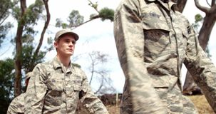 Military troops walking at boot camp 4k. Military troops walking at boot camp on a sunny day 4k stock footage