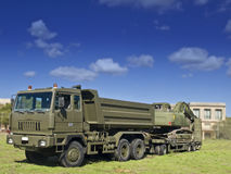 Military Truck. Military heavy truck and mechanical shovel in tow Royalty Free Stock Photography