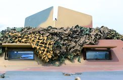 Military truck with camouflage gear for war missions Stock Image