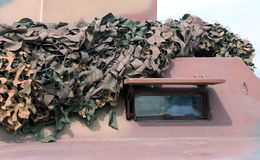 Military truck with camouflage gear for war missions Royalty Free Stock Photos