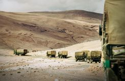 Military Truck Convoy on the high mountain Leh - Manali highway. On Jammu and Kashmir, Nothern India royalty free stock images