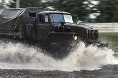 Military truck. Military truck driving through the water Royalty Free Stock Image