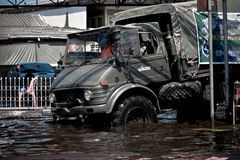 Military Truck Stuck in the Middle of Flood Royalty Free Stock Image