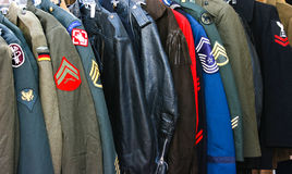 Military Uniform. Different Military Uniform on hangers Stock Images