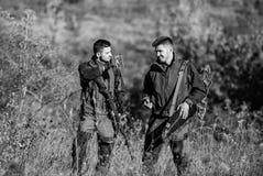 Military uniform fashion. Hunting skills weapon equipment. How turn hunting into hobby. Friendship of men hunters. Man royalty free stock photo