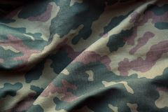 Military uniform pattern with blur effect. Stock Photos