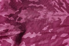 Military uniform pattern with blur effect in pink tone. Abstract background and texture Stock Photos