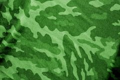 Military uniform pattern in green tone. Royalty Free Stock Images