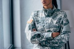 Military uniform with usa flag emblem. Cropped view of african american female soldier in military uniform with usa flag emblem Stock Photography