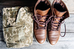 Military uniform on Wooden floor Stock Image