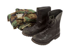 Military uniforms. Military camouflage uniforms and boots. White isolated Royalty Free Stock Image