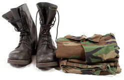 Military uniforms. Military camouflage uniforms and boots Stock Image