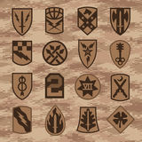 Military unit patch insignia set on tan camouflage Stock Photography