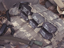 Military unloading cartridges. The tactical bulletproof vest with M4 magazines, selective focus Stock Photos