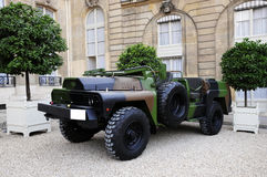 Military vehicle. Stop in classic building stock photos