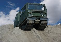 Military vehicle. On a sand hill royalty free stock image