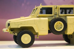 Military vehicle. Yellow military armored vehicle; appears to be on display royalty free stock image