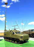Military vehicle with antennas. Military armored tracked vehicle with antennas for field communication royalty free stock image
