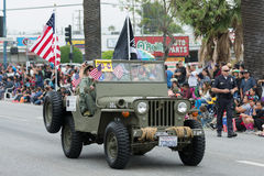 Military vehicle with flags during Memorial Day Parade Royalty Free Stock Photo