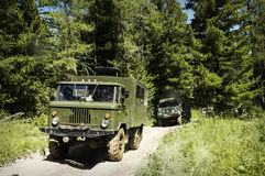 Military vehicle in the forest, Royalty Free Stock Photo