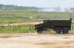 Military vehicle goes on the dusty road. The military vehicle goes on the dusty road Stock Images