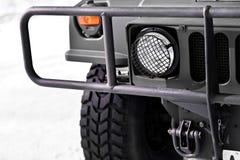 Military vehicle headlight and crash bar. Detail with military vehicle headlight and protection crash bars stock images