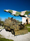 Military vehicle and MIG 21 airplane Royalty Free Stock Images
