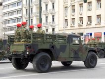 Military Vehicle in a Parade. A military vehicle and its crew during a parade stock images